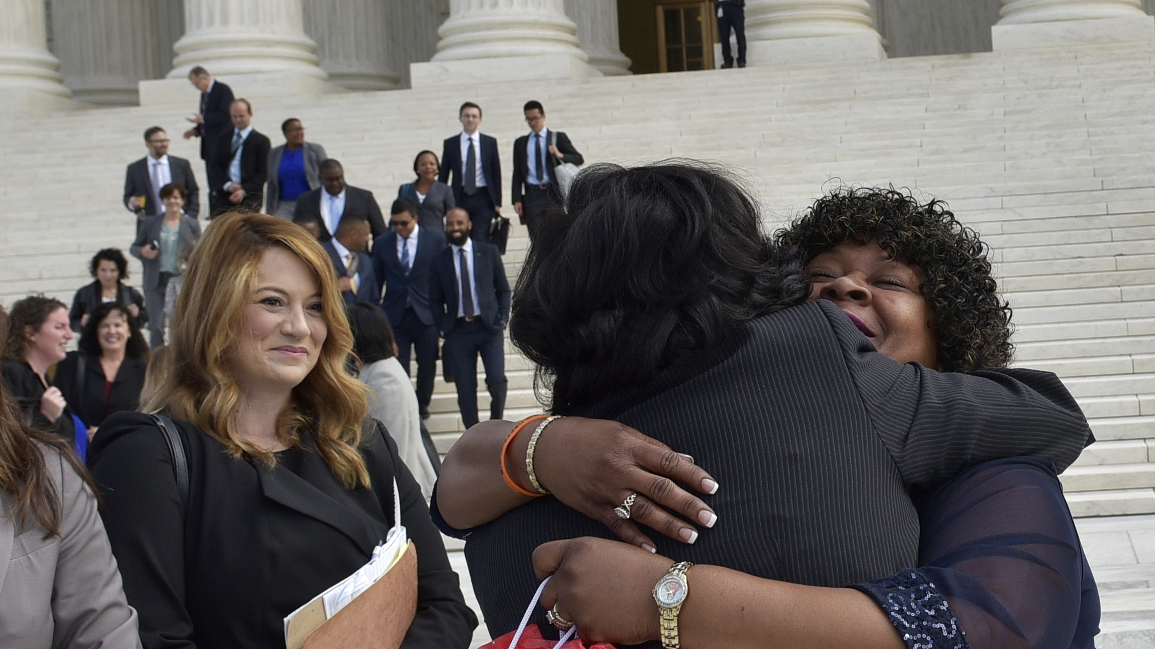 Christina Swarns, center, the lead counsel for Duane Buck, is embraced by Buck's stepsister Phyllis Taylor, right, outside of the U.S. Supreme Court on Oct. 5 in Washington, D.C. (Photo by Mandel Ngan/AFP/Getty Images)