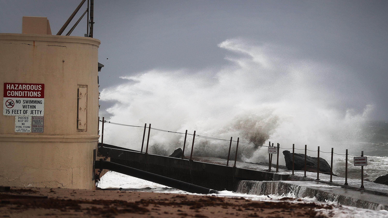 Waves crash ashore on Singer Island, Fla., as Hurricane Matthew approaches the area Thursday.