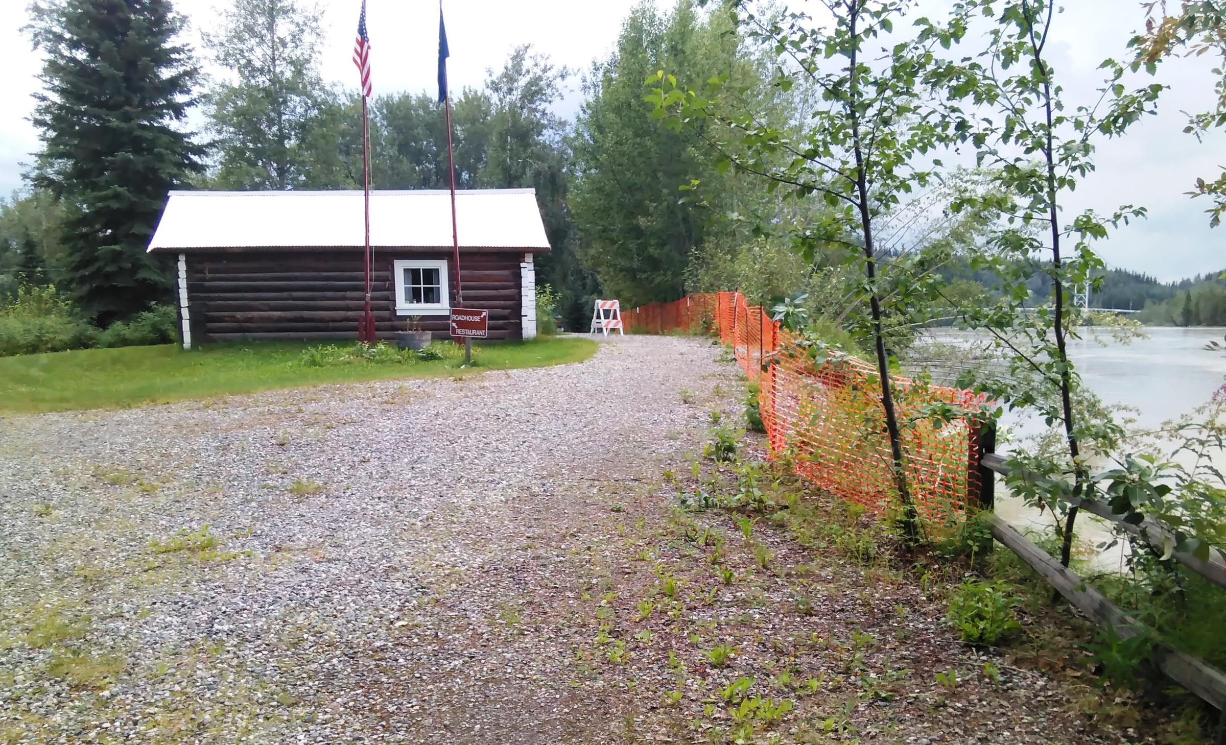Alaska State Parks is trying to raise money for a riverbank-stabilization project that would halt the Tanana River from washing away the bank that's already been eroded to within 13 feet of this historic cabin at Big Delta State Historical Park. (Photo by Monica Gray/ Alaska State Parks )