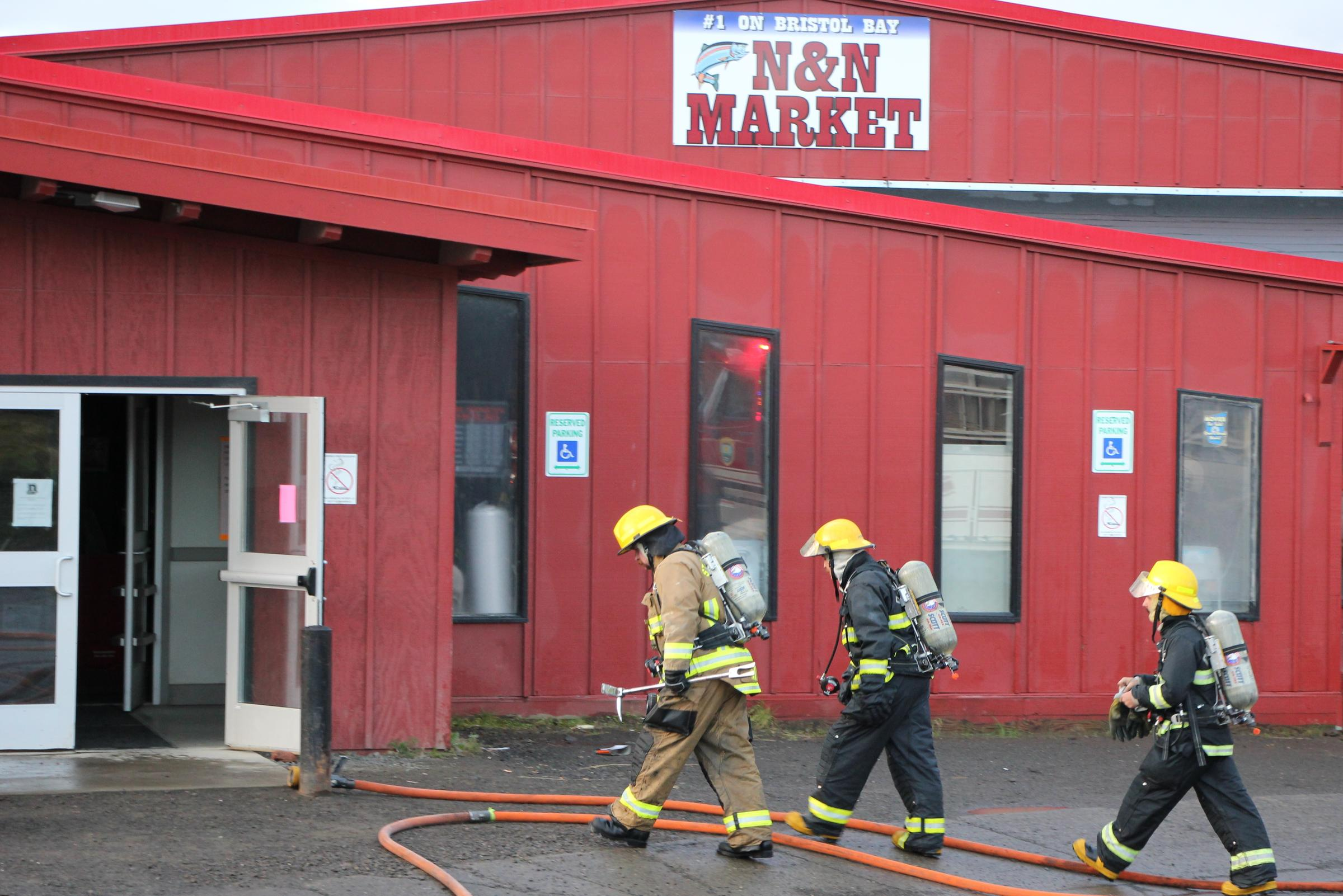 More than a dozen volunteer firefighters helped put out the fires inside the N&N grocery store Sunday morning. (Photo by KDLG)