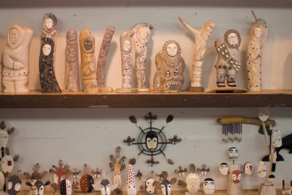 Walrus ivory carvings and masks, like these on display at Maruskiya's in Nome, may be threatened by other states' bans on the sale, purchase, and trade of various types of ivory. (Photo by Emily Russell/KNOM)