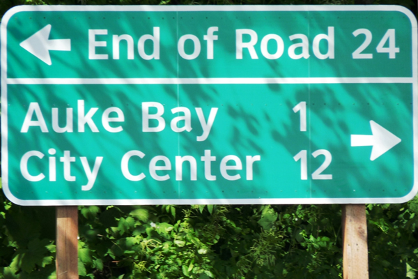 A sign near Juneau's Auke Bay Ferry Terminal points to the end of Glacier Highway. (Photo by Ed Schoenfeld/CoastAlaska News)