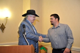 Hydaburg Mayor Tony Christianson accepts an award from the U.S. Forest Service in May, 2013.