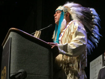 Yakama Chairman JoDe Goudy speaks to a crowd AT THE Alaska Federation of Natives Convention in Fairbanks, Alaska. (Photo by Emily Schwing/Northwest News Network)