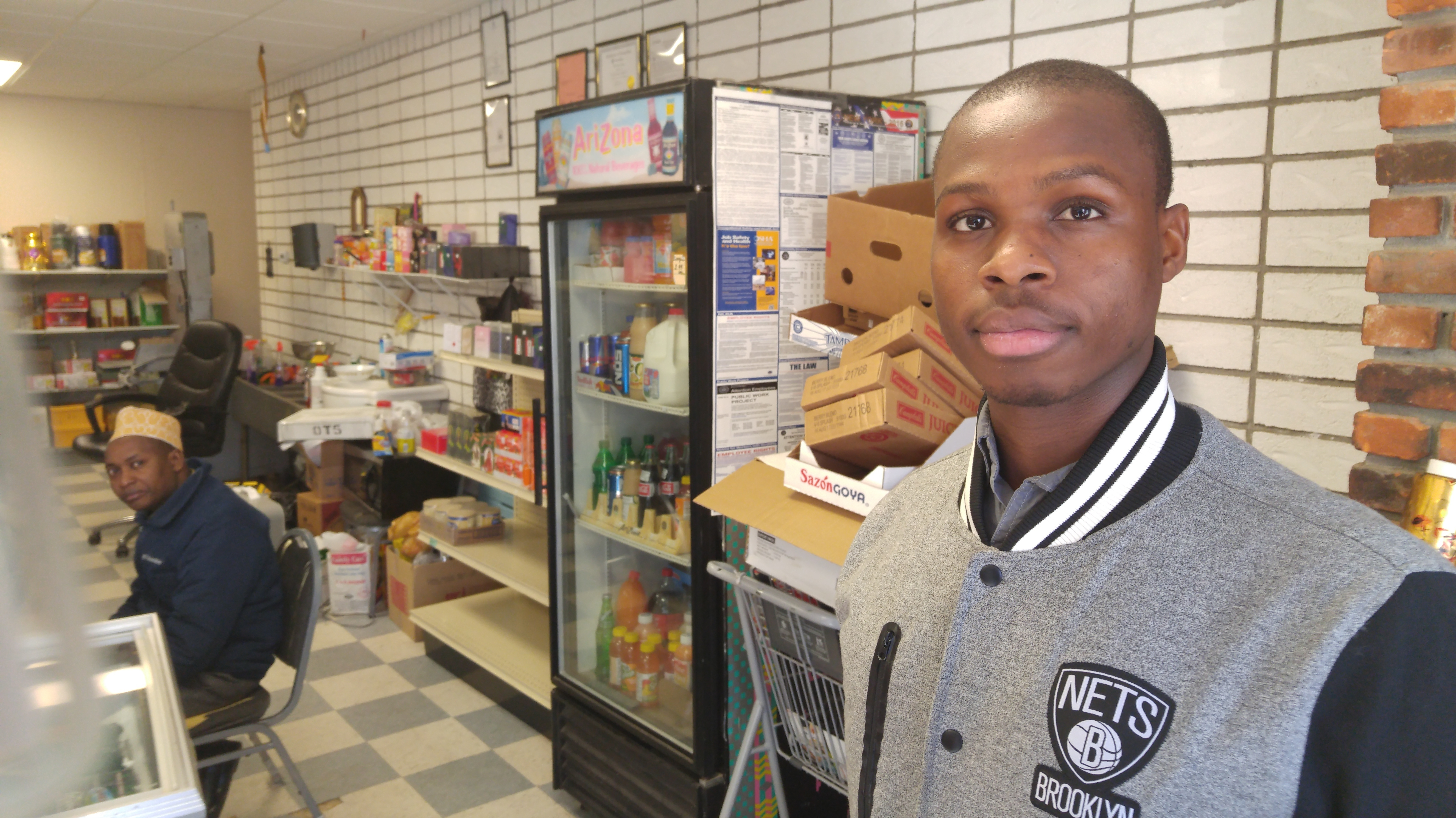 Mohamed Gabril, a refugee who became an American citizen, works at a Somali-owned grocery in Utica, N.Y. He's convinced the U.S. Constitution will protect him from any backlash under Donald Trump. Brian Mann/NCPR