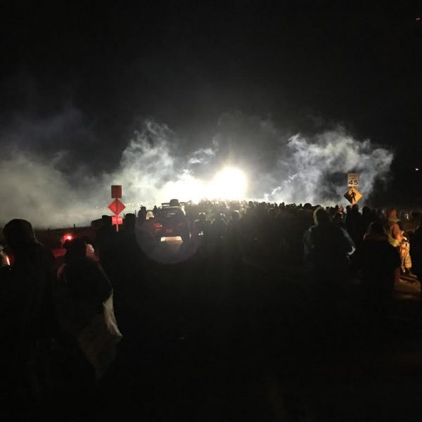 Demonstrators who call themselves water protectors faced law enforcement officers who fired rubber bullets and water cannons in below freezing temperatures near Cannon Ball, ND on the evening of Sunday, Nov. 20. (Photo courtesy of Tracy Peterson)