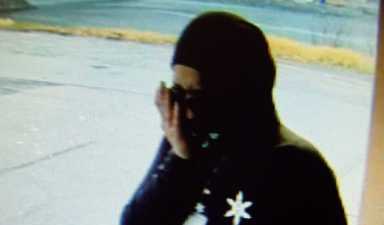 Surveillance video still of woman police believe planned to rob the Douglas Breeze In, Sunday.