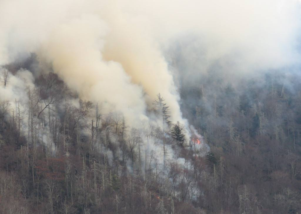 Smoke rises from wildfires in the Great Smoky Mountains near Gatlinburg, Tenn., on Tuesday. (Photo by Great Smoky Mountains National Park)