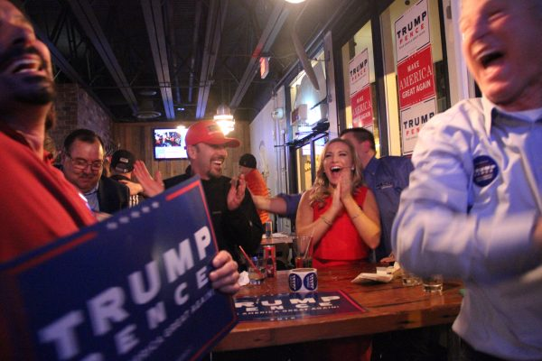 George LaMoureaux, statewide volunteer coordinator for the Trump campaign, celebrated with his daughter, Ashley LaMoureaux, at Flattop Pizza in downtown Anchorage. (Photo by Rachel Waldholz/Alaska's Energy Desk)