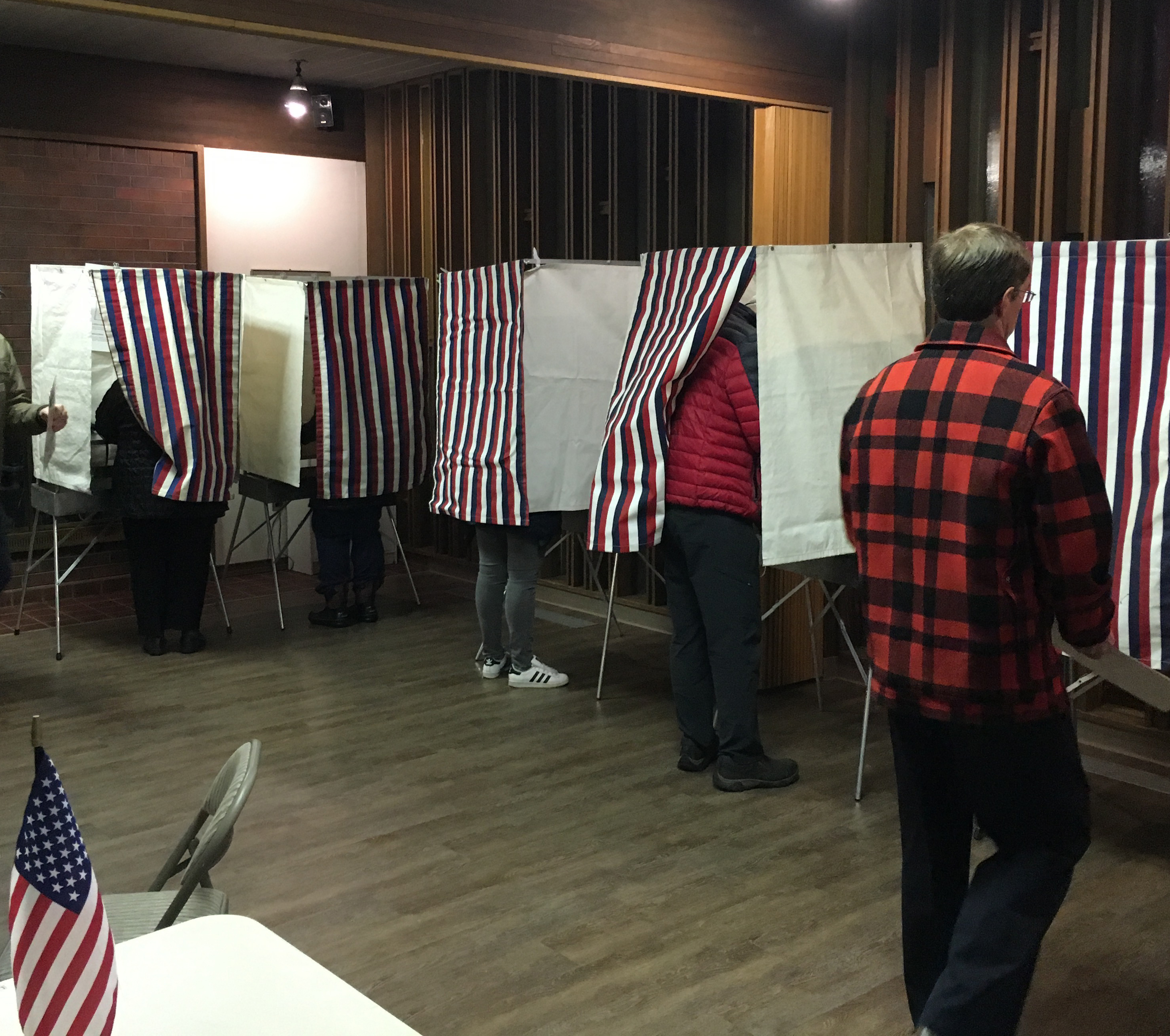 Voters fill out ballots Tuesday at First American Baptist Church in Anchorage. Only two House seats changed hands. Nov. 8, 2016. (Photo by Andrew Kitchenman/KTOO/APRN)