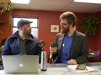 Justin Parish speaks with his campaign manager at a coffee shop in the Mendenhall Valley. (Photo by Lakeidra Chavis/ KTOO)