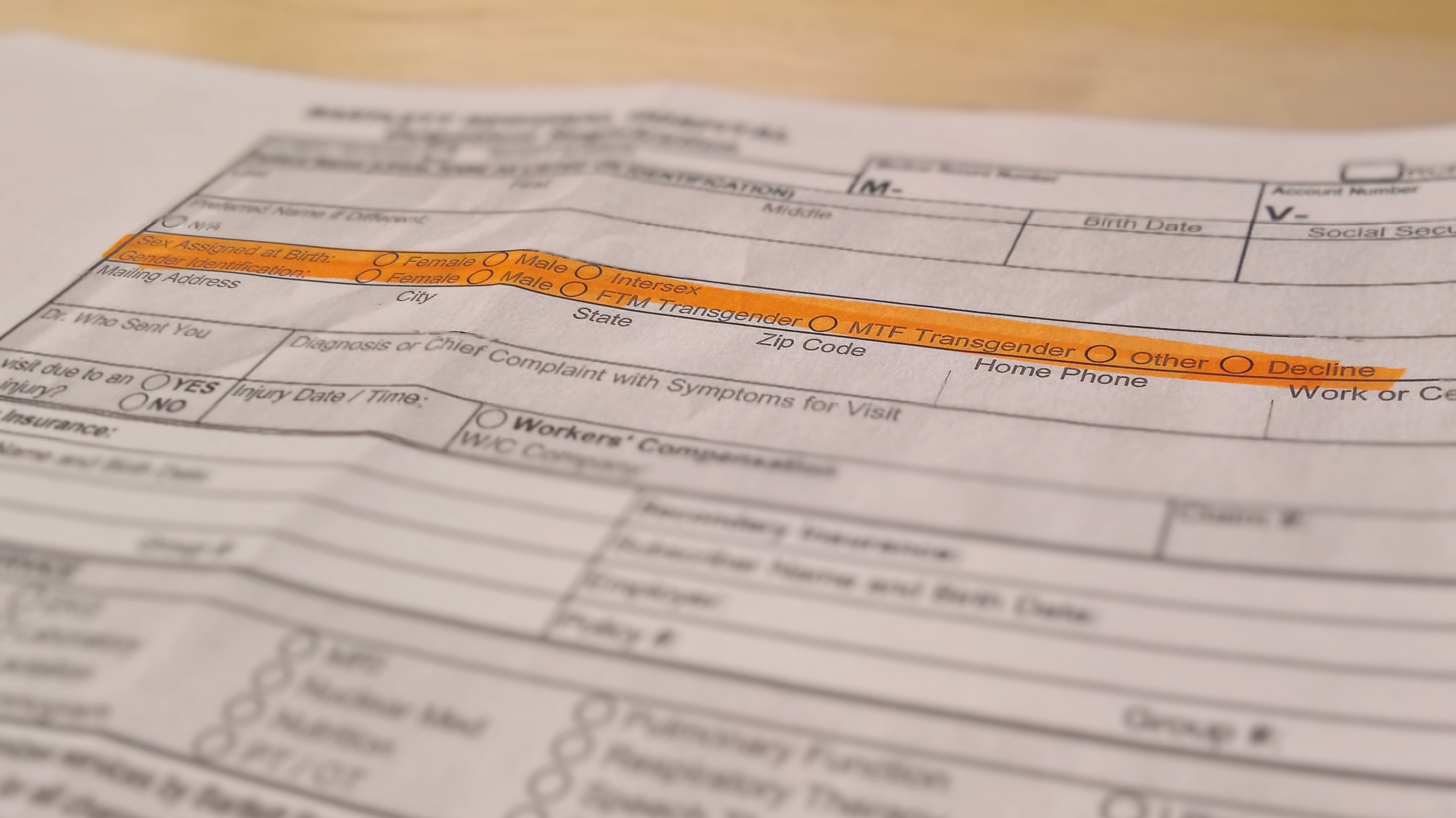 A copy of Bartlett Regional Hospital's new outpatient registration form asks for sex assigned at birth and gender identification with expanded options. The hospital announced the change in response to a new federal rule tied to the Affordable Care Act on Nov. 17, 2016. (Photo illustration by Jeremy Hsieh/KTOO)
