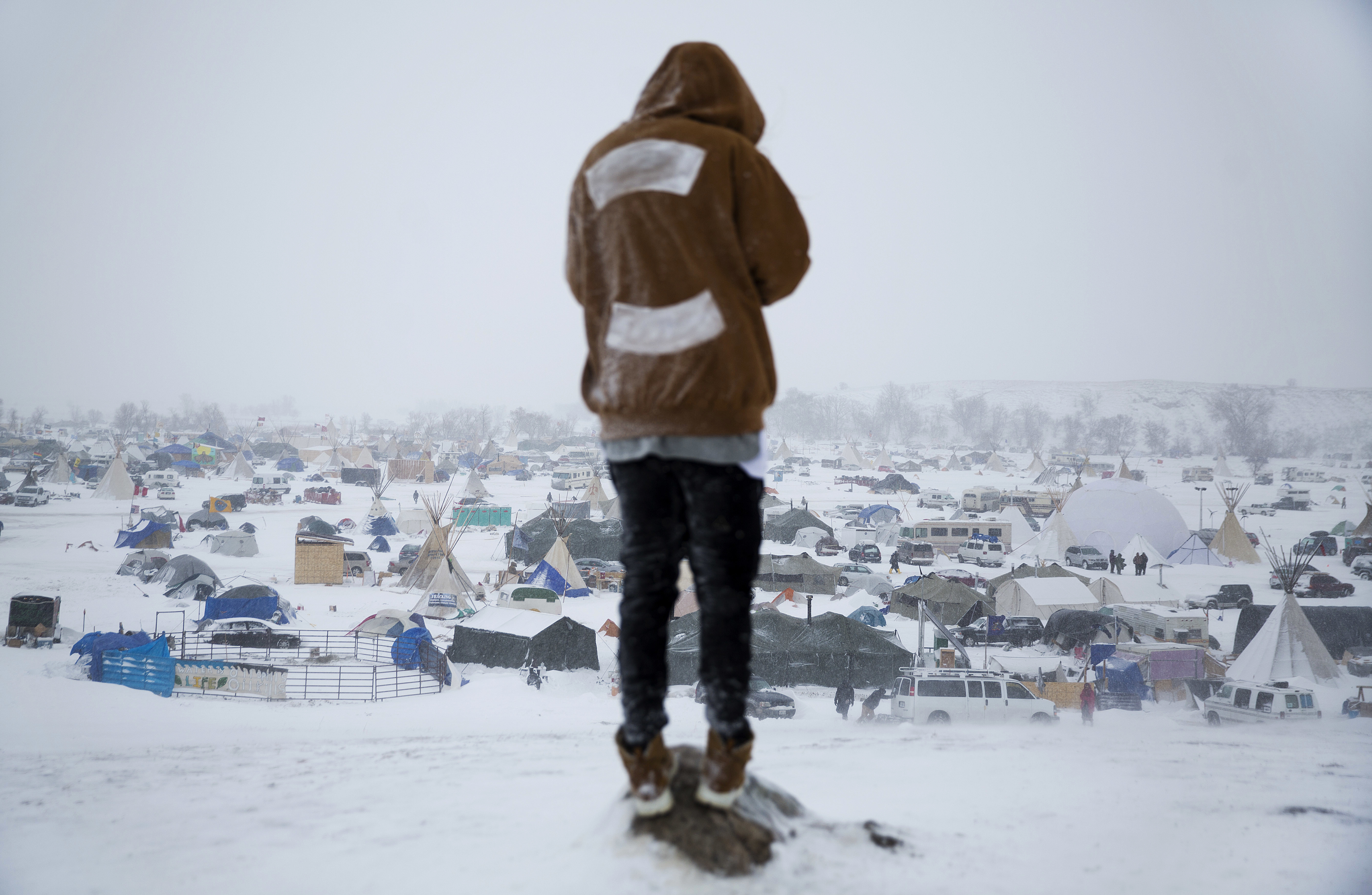 Damin Radford of New Zealand overlooks the Oceti Sakowin camp on Tuesday, where people have gathered to protest the Dakota Access pipeline near Cannon Ball, N.D.