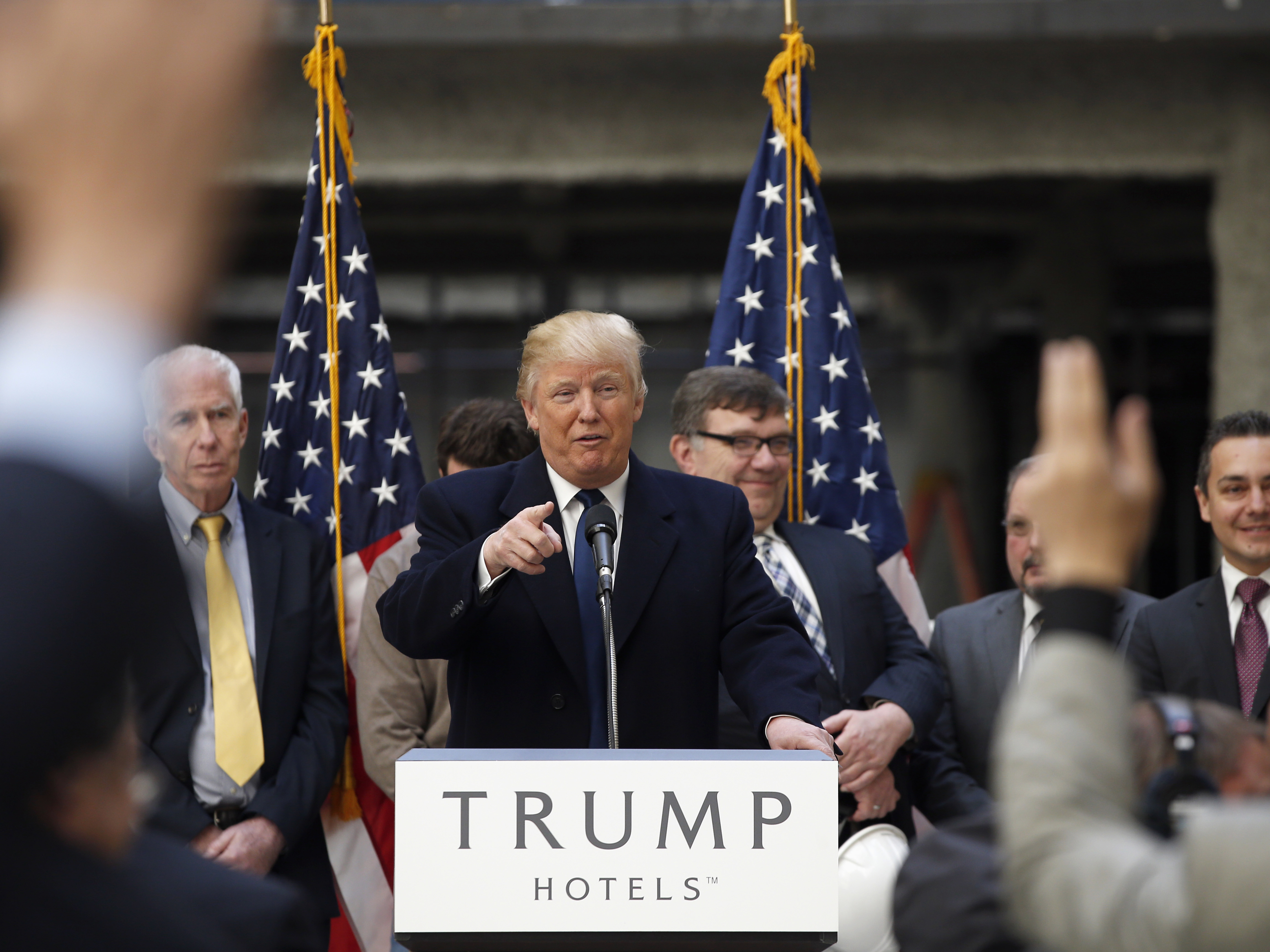 President-elect Donald Trump points to a reporter at Trump International Hotel in Washington.