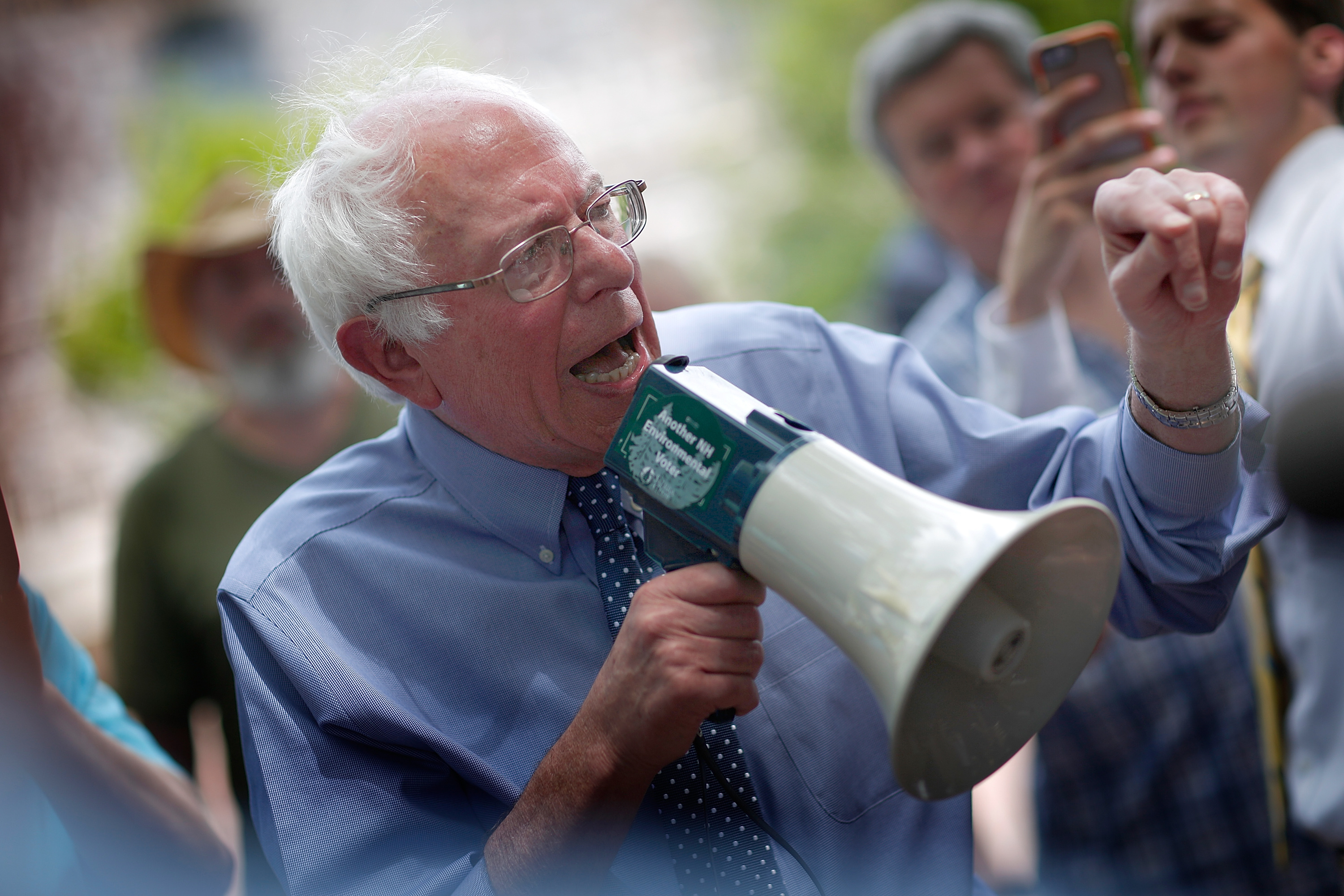 Democratic presidential candidate Sen. Bernie Sanders (I-VT) speaks to an overflow crowd through a megaphone after a campaign event at the New England College May 27, 2015 in Concord, N.H.