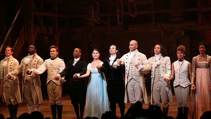 "Leslie Odom Jr., Phillipa Soo and Ariana DeBose with Lin-Manuel Miranda with the cast during their final performance curtain call of ""Hamilton"" in July. Walter McBride/WireImage"