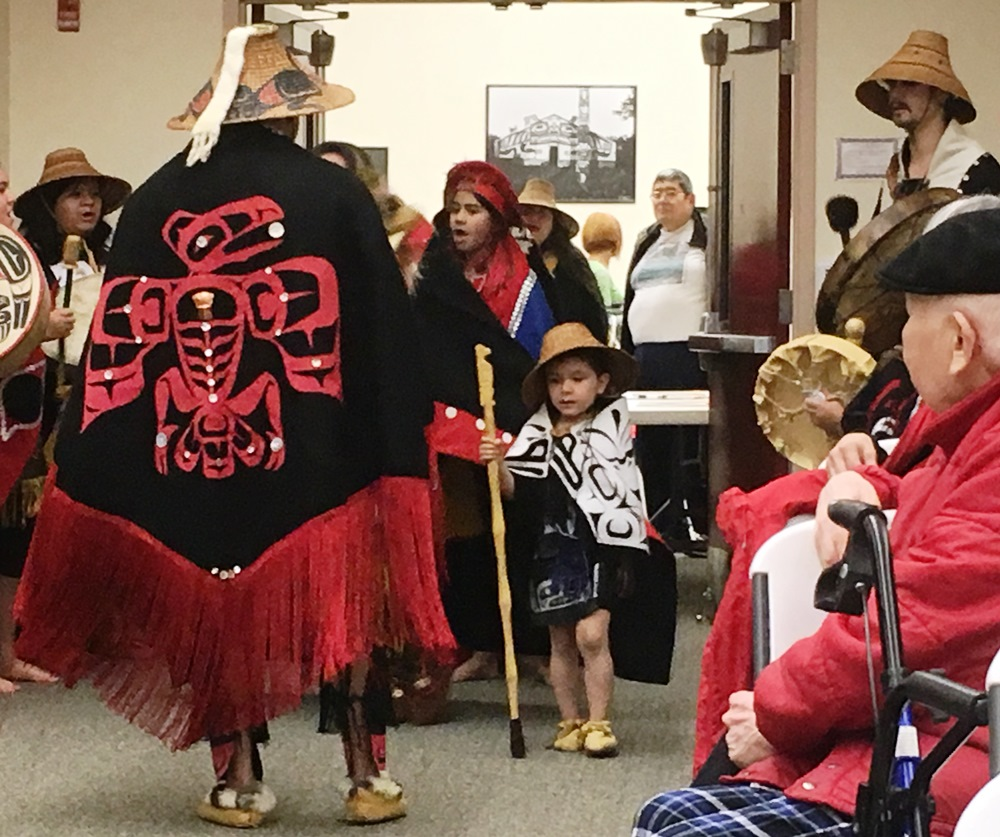 Kevin Clevenger displays his regalia as the New Path Dancers enter the Saxman Community Hall on Wednesday. (Photo by Leila Kheiry/KRBD)