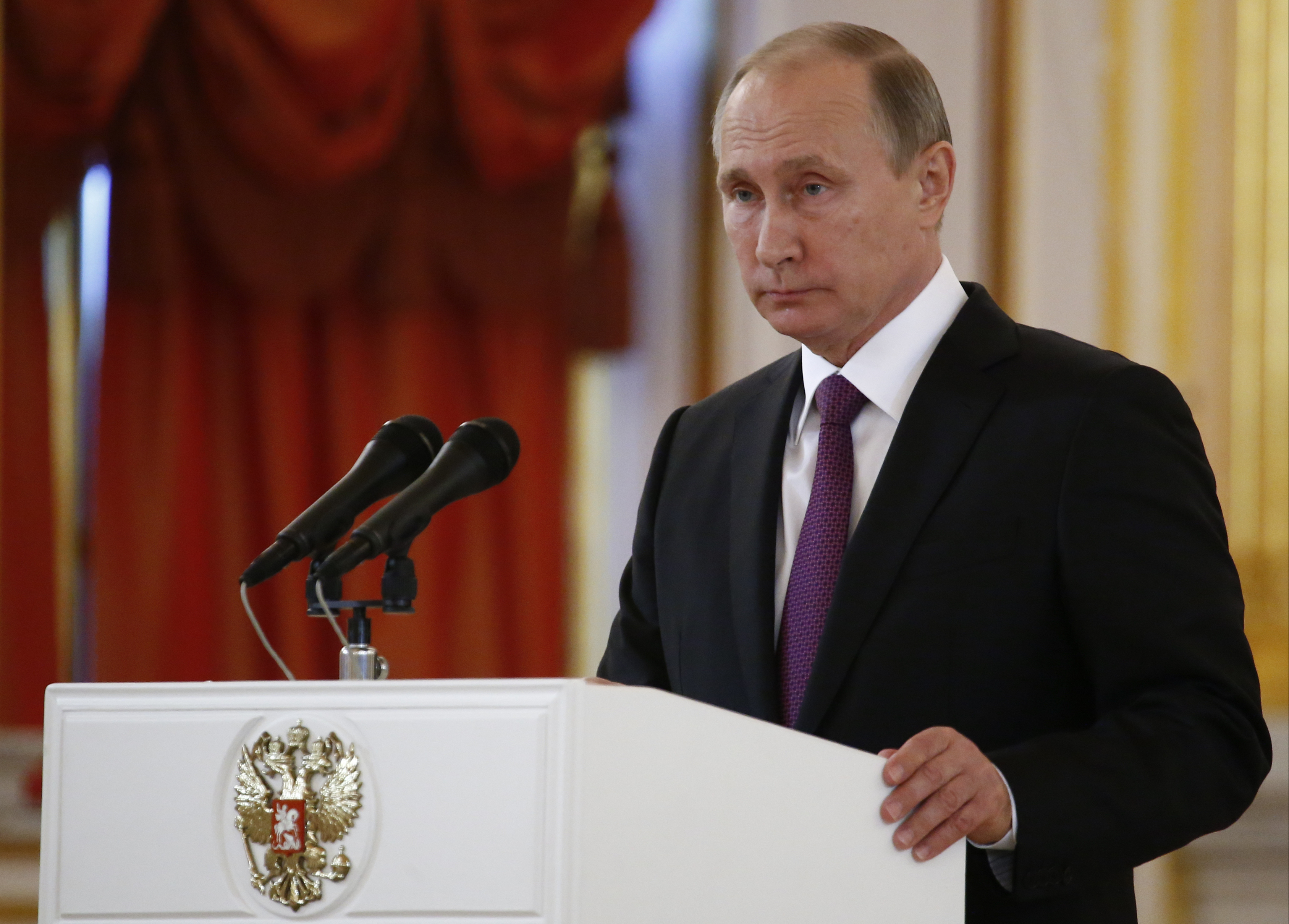 Russian President Vladimir Putin speaks at the Kremlin on Wednesday. Putin says that Moscow hopes to restore good relations with the United States in the wake of the election of Donald Trump.