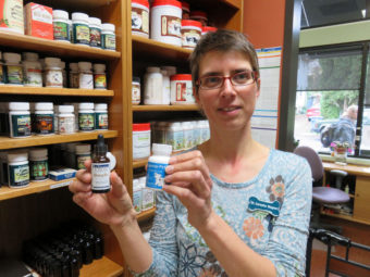 Dr. Cornelia Wagner shows several hemp-based supplements for pets stocked by the Hawthorne Veterinary Clinic. (Tom Banse/ Northwest News Network)