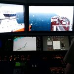 During a simulation, Glenn Burleigh practices piloting a tanker with a damaged rudder. (Photo by Zoë Sobel/KUCB)