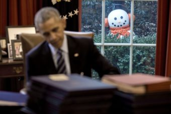 A snowman peeks into the Oval Office as President Barack Obama signs end-of-the-year bills, Dec. 16, 2016. Staff moved four snowmen that were decorating the Rose Garden just outside several Oval Office windows to greet the President when he arrived in the office.