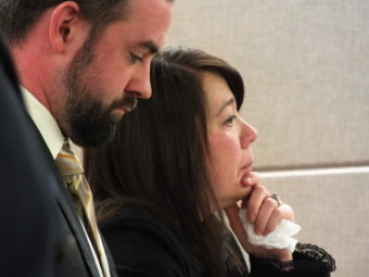 Defense attorney Kevin Higgins and defendant Christena Leamer listen as District Attorney James Scott speaks during a sentencing hearing on Wed., Dec. 15.