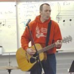 Gastineau Elementary School music teacher Patrick Murphy leads his class in song. (Photo by Ed Schoenfeld/CoastAlaska News)
