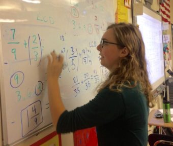 Madelene Reichard teaches seventh graders how to add and subtract unlike fractions at Bethel Regional High School. Reichard graduated from BRHS and a LKSD Board scholarship funded a portion of her college education.