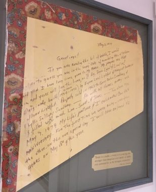Letter written on the wall by Phyllis Sundberg, framed in the house in which it was found. (Photo by Kayla Desroches/KMXT)
