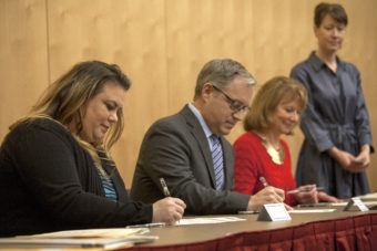 Jacqueline Tupou, Sean Parnell and Carolyn Leman sign their Electoral College votes for Donald Trump during a ceremony on Monday Jan. 19, 2016 in Juneau, Alaska. (Photo by Rashah McChesney/Alaska's Energy Desk)