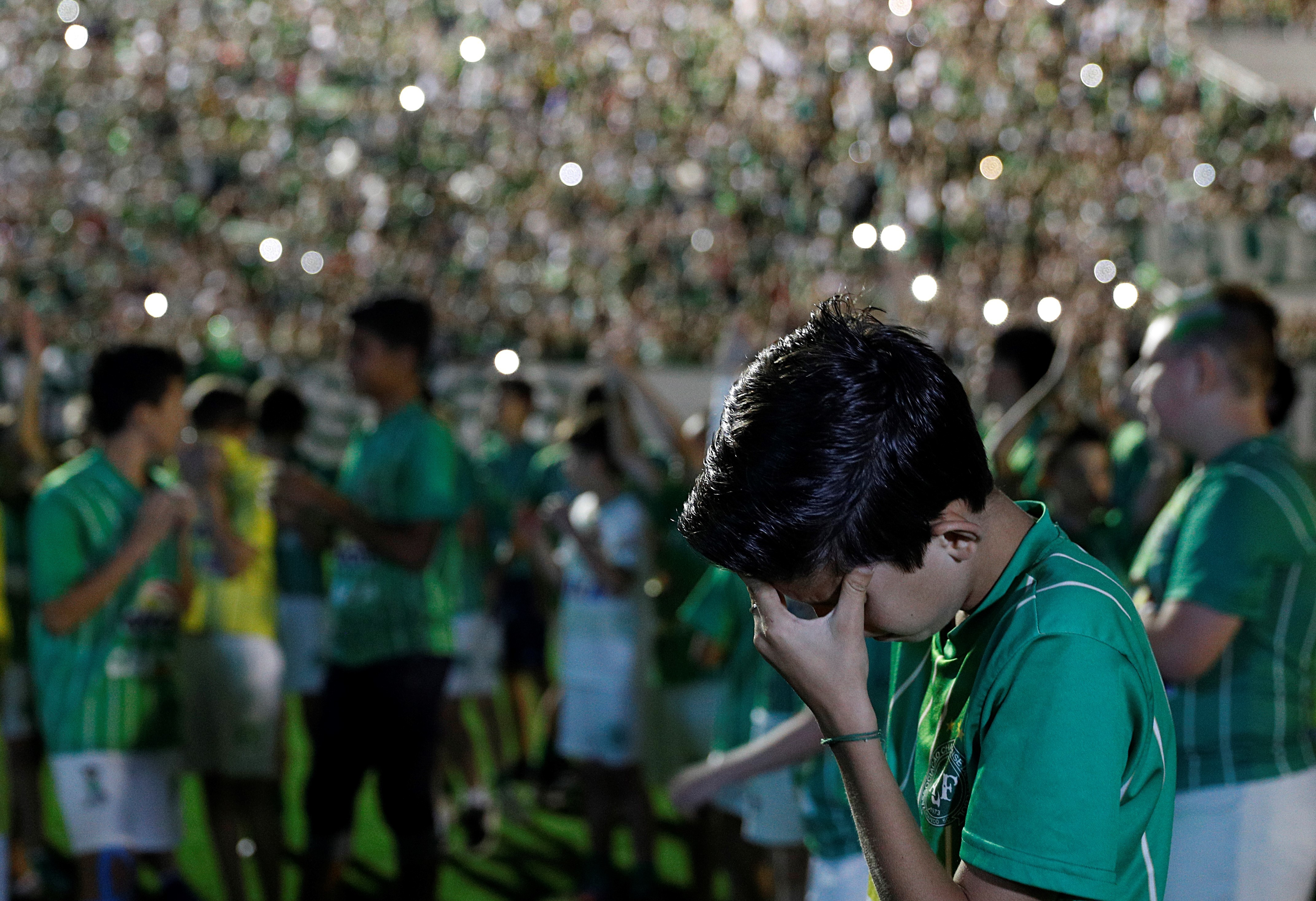 Fans of Chapecoense pay tribute to the players of the Brazilian soccer team on Wednesday.