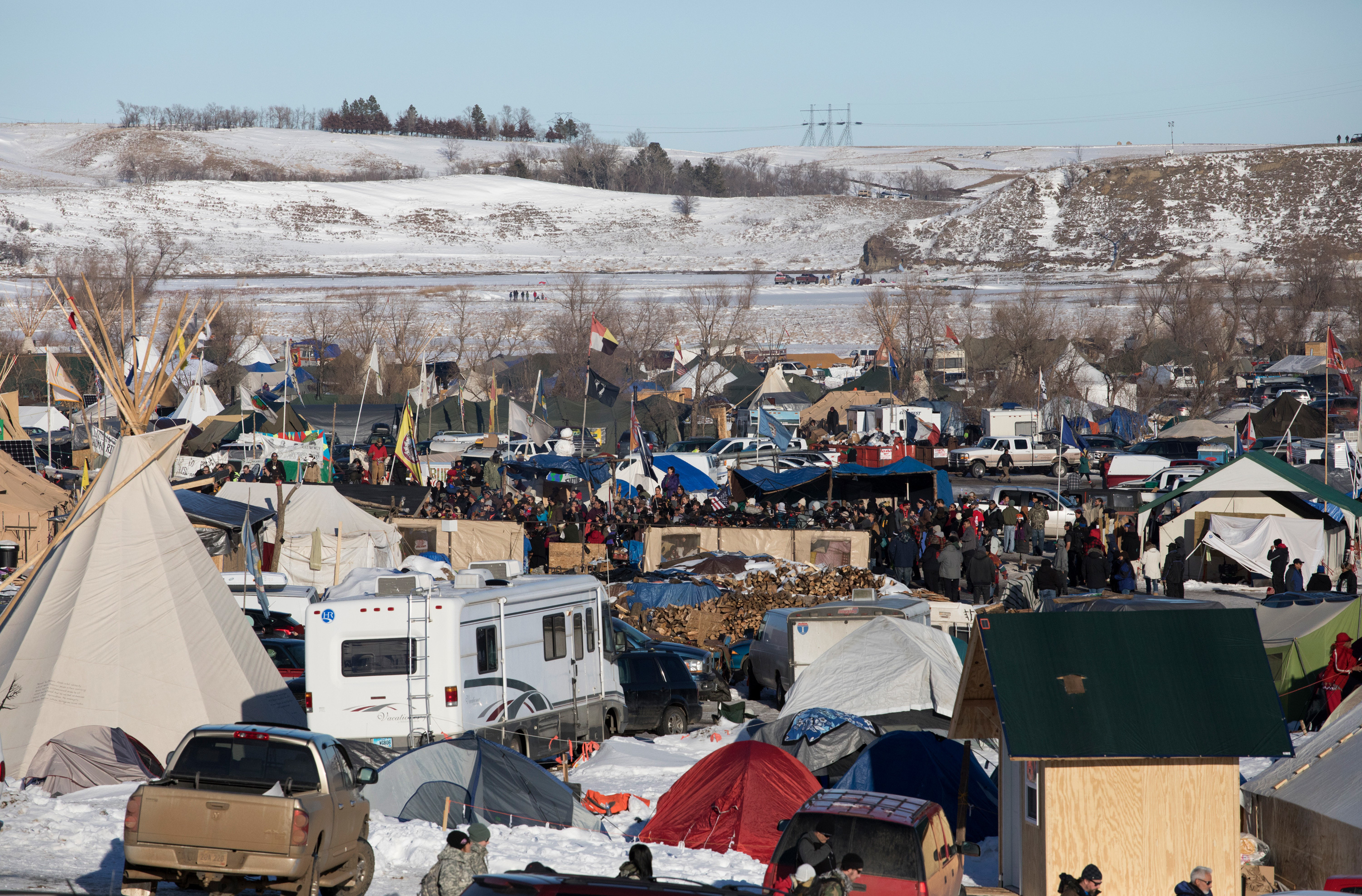 On Sunday, protesters gather at their camp as news breaks that the Army Corps of Engineers will not approve an easement for the Dakota Access Pipeline. (Photo by Cassi Alexandra for NPR)