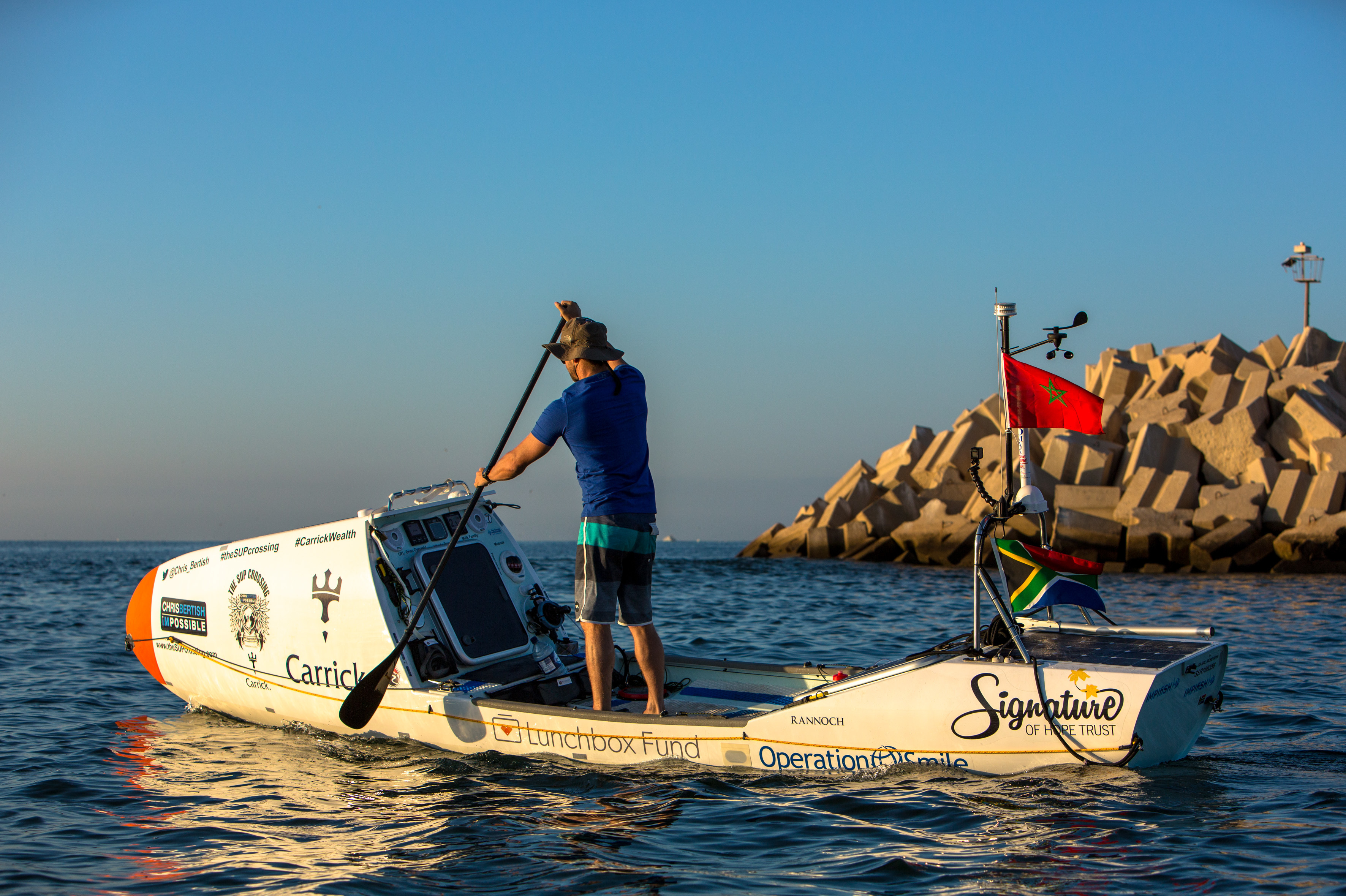 South African surfer and sailor Chris Bertish practices in his 20-foot stand-up paddleboard, just days prior to his launch on Tuesday.