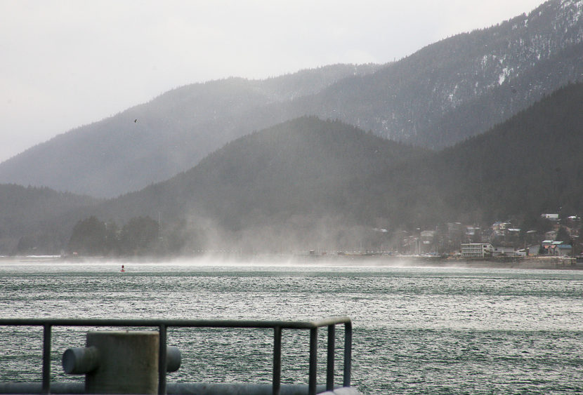 A cold weather phenomenon known as the Taku winds causes white caps and water to mist into the air on Friday, January 6, 2017, on the Gastineau Channel as seen from the U.S. Coast Guard Juneau station. National Weather Service issued a high wind warning for Juneau and Southeast Alaska that will last until Sunday afternoon, January 8, 2017. The warning was for hazardous high winds of about 60 to 80 mph. (Photo by Tripp J Crouse/KTOO)