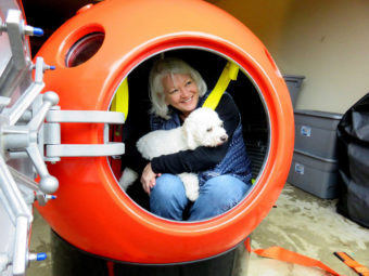 Jeanne Johnson of Ocean Park, Washington, is the first U.S. buyer of a tsunami pod sold by Mukilteo, Washington-based Survival Capsule LLC. (Photo by Tom Banse/Northwest News Network)