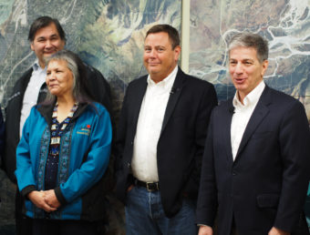 Eklutna Inc. board members Michael Curry, left, and Maria Coleman stand next to Eklutna CEO Curtis McQueen and Anchorage Mayor Ethan Berkowitz at a news conference in Eagle River on January 4, 2017. (Photo by Zachariah Hughes, Alaska Public Media)