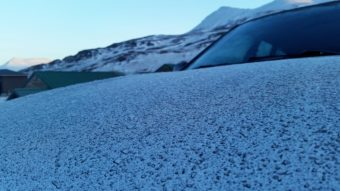 A fine layer of volcanic ash covers a car in Unalaska. Scientists say the minimal ash fall is not a health risk for island residents. (Photo by Zoe Sobel/KUCB)