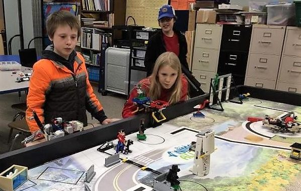 As part of the competition, the middle-schoolers program their Lego robot to perform a series of missions on a tabletop arena. (Photo courtesy of Marj Dunn)