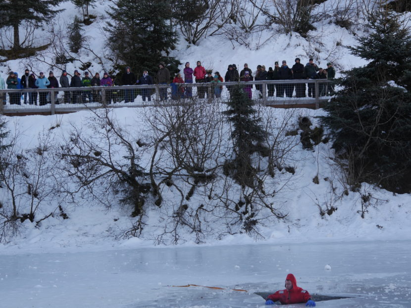A member of the CCFR water rescue team voluntarily went into the icy water to demonstrate how to escape.