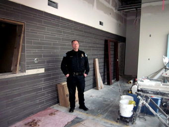 Petersburg Police Chief Kelly Swihart stands in the unfinished lobby near the front entrance of the new police department. (Photo by Angela Denning/KFSK)