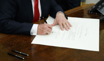 President Trump signs a confirmation for James Mattis to be defense secretary, Friday in the Oval Office. Evan Vucci/AP