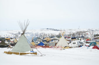 Several hundred protesters remain camped on the North Dakota prairie in opposition to the Dakota Access Pipeline. They have erected shelters from Army tents to teepees to wooden structures to stay warm this winter. (Photo by Amy Sisk/Inside Energy)