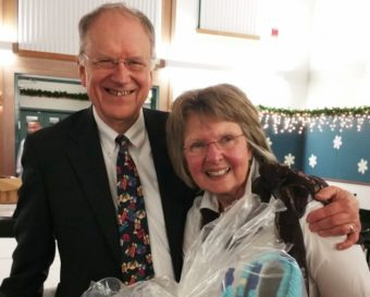 Retiring Dr. David Johnson and his wife, Jenny, are seen at the PeaceHealth Ketchikan holiday party. (Photo by PeaceHealth)