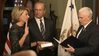 Betsy DeVos is sworn in by Vice President Mike Pence as the Secretary of Education. (Screenshot from White House video)