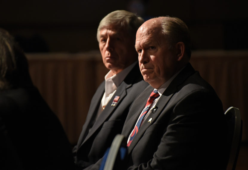 Gov. Bill Walker, right, and Lt. Gov. Byron Mallott listen during a Q&A session to discuss legislators' plans for reorganizing the Permanent Fund in April 2016.