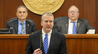 U.S. Sen. Dan Sullivan, R-Alaska, gives his annual address to the Alaska Legislature, Feb. 29, 2016. Behind him from left to right are Senate President Kevin Meyer and House Speaker Mike Chenault. (Photo by Skip Gray/360 North)