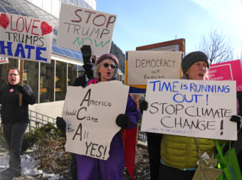 Protesters take part in a rally on Feb. 24, 2017, in front of the Alaska Capitol to encourage U.S. Sen. Dan Sullivan to hold a town meeting. Sullivan was at the Capitol earlier in the day to give his annual address to the Alaska Legislature. (Photo by Skip Gray/360 North)