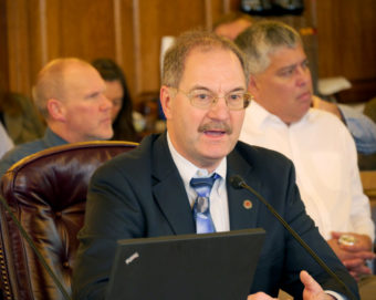 David Teal, Fiscal Analyst for the Alaska Legislature, runs through various budget models related to HB-115 for the House Finance Committee, February 15, 2017. HB-115 creates a state income tax, draws money from the Permanent Fund for the state budget and introduces a new formula for setting the amount of the Permanent Fund dividend. (Photo by Skip Gray/360 North)