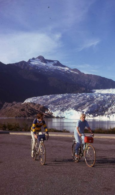 Mike and Marilyn Miller on bicycles in front of the Mendenhall Glacier in this 1975 photo.
