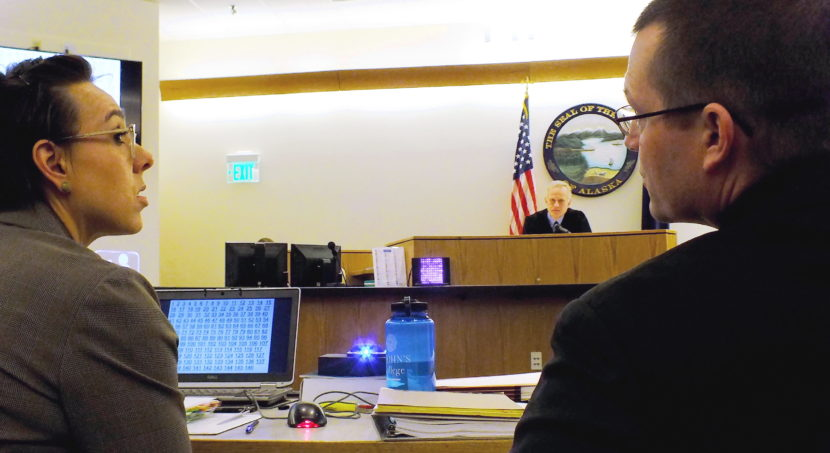 Assistant District Attorney Amy Paige confers with Juneau Police Sgt. Shawn Phelps before responding to Judge Philip Pallenberg during trial on Friday, Feb. 10, 2017.